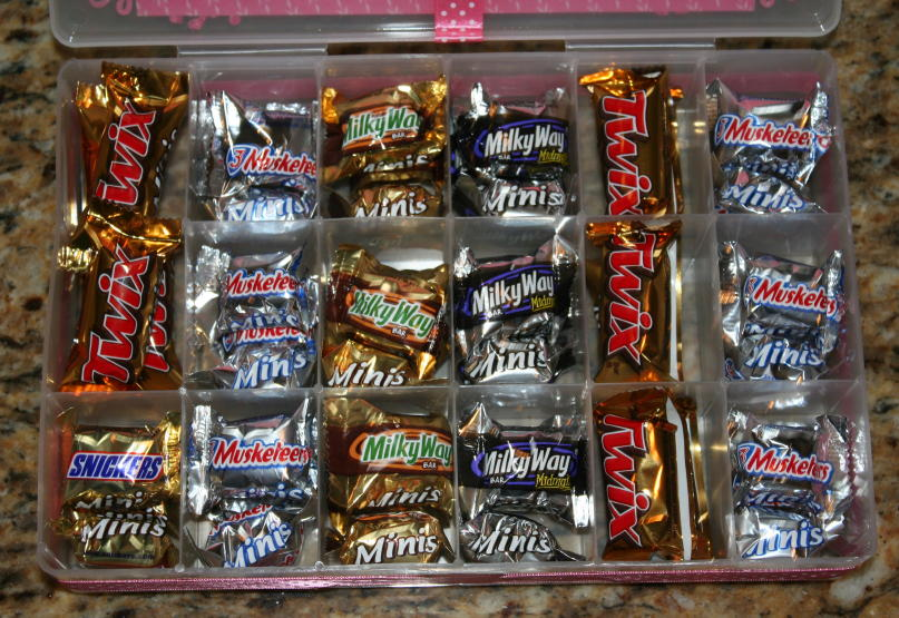 put 3 mini candy bars in each small space and about 6 of the Twix in ...