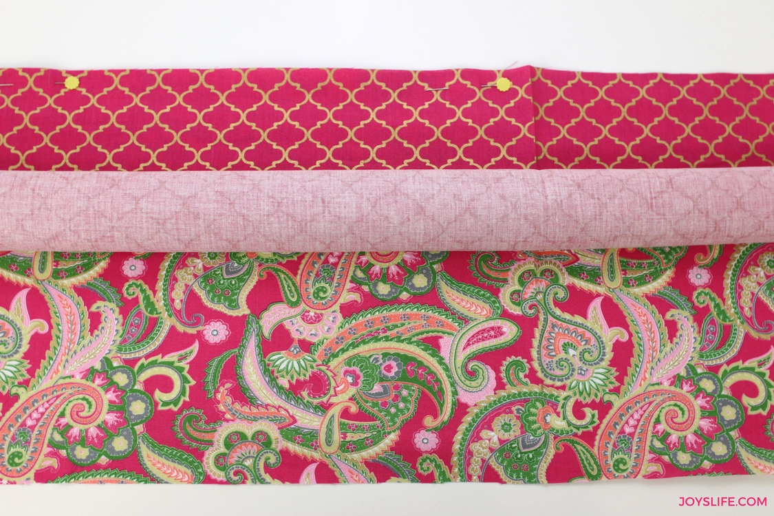 roll pink fabric pinned edges