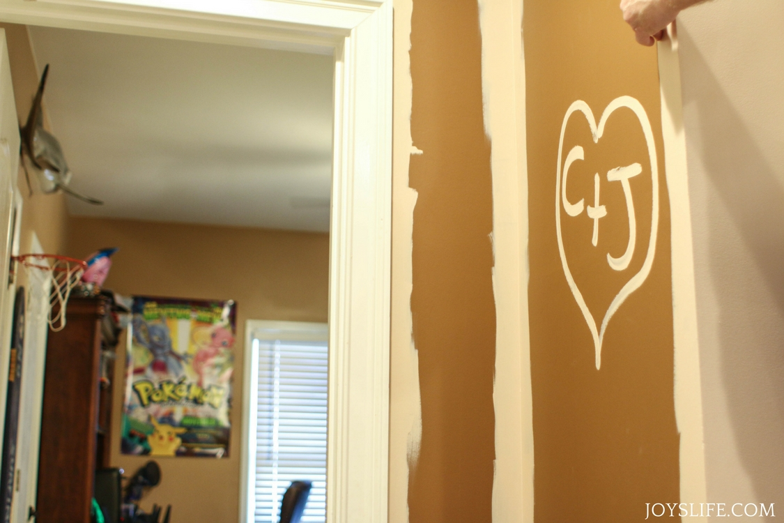 painted initials in hallway