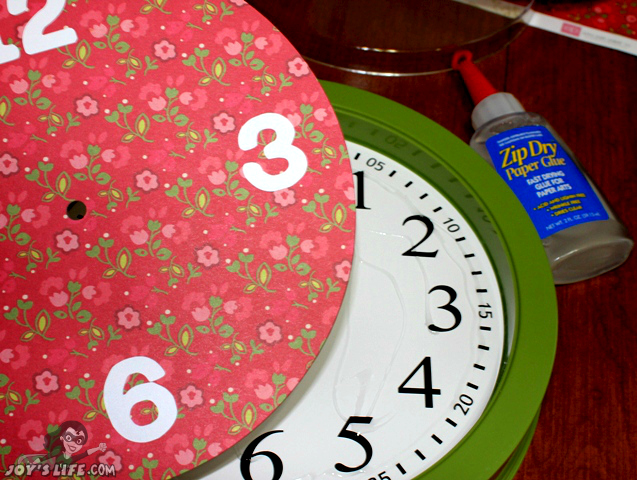 I used Zip Dry to glue in the new clock face.