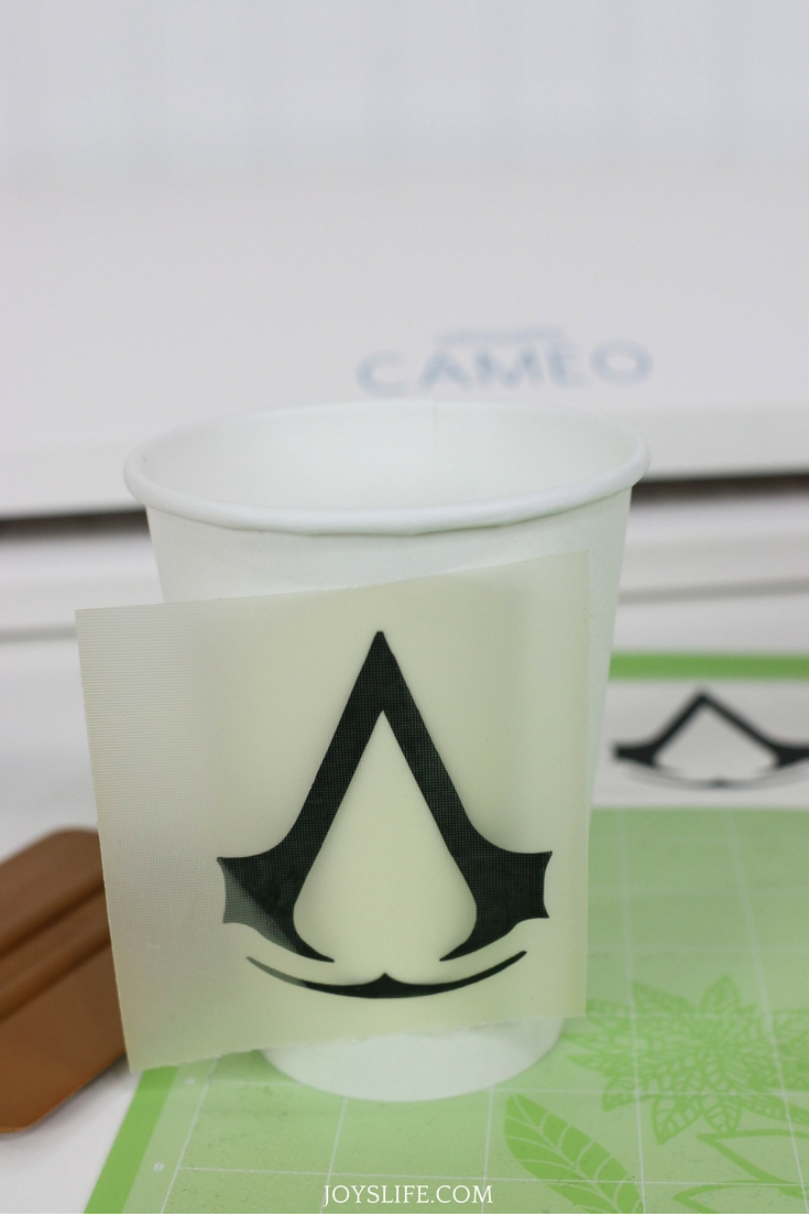 Assassin's Creed black vinyl symbol applied with transfer tape
