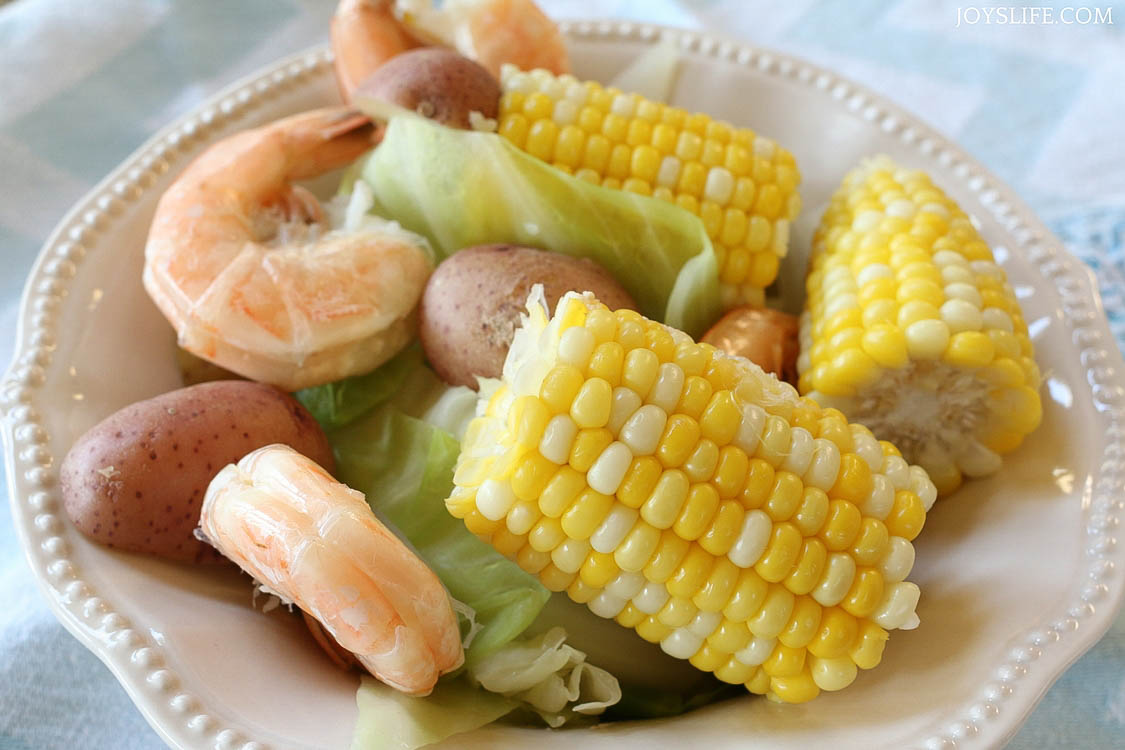 shrimp corn cabbage potato bowl ready to serve