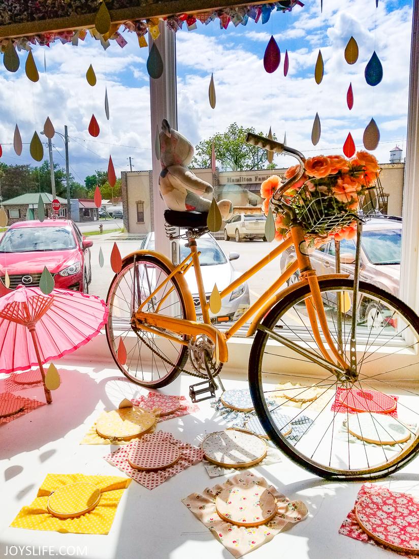 Amazing Rainy Weather Flower Basket Bike Pink Umbrella Window Display