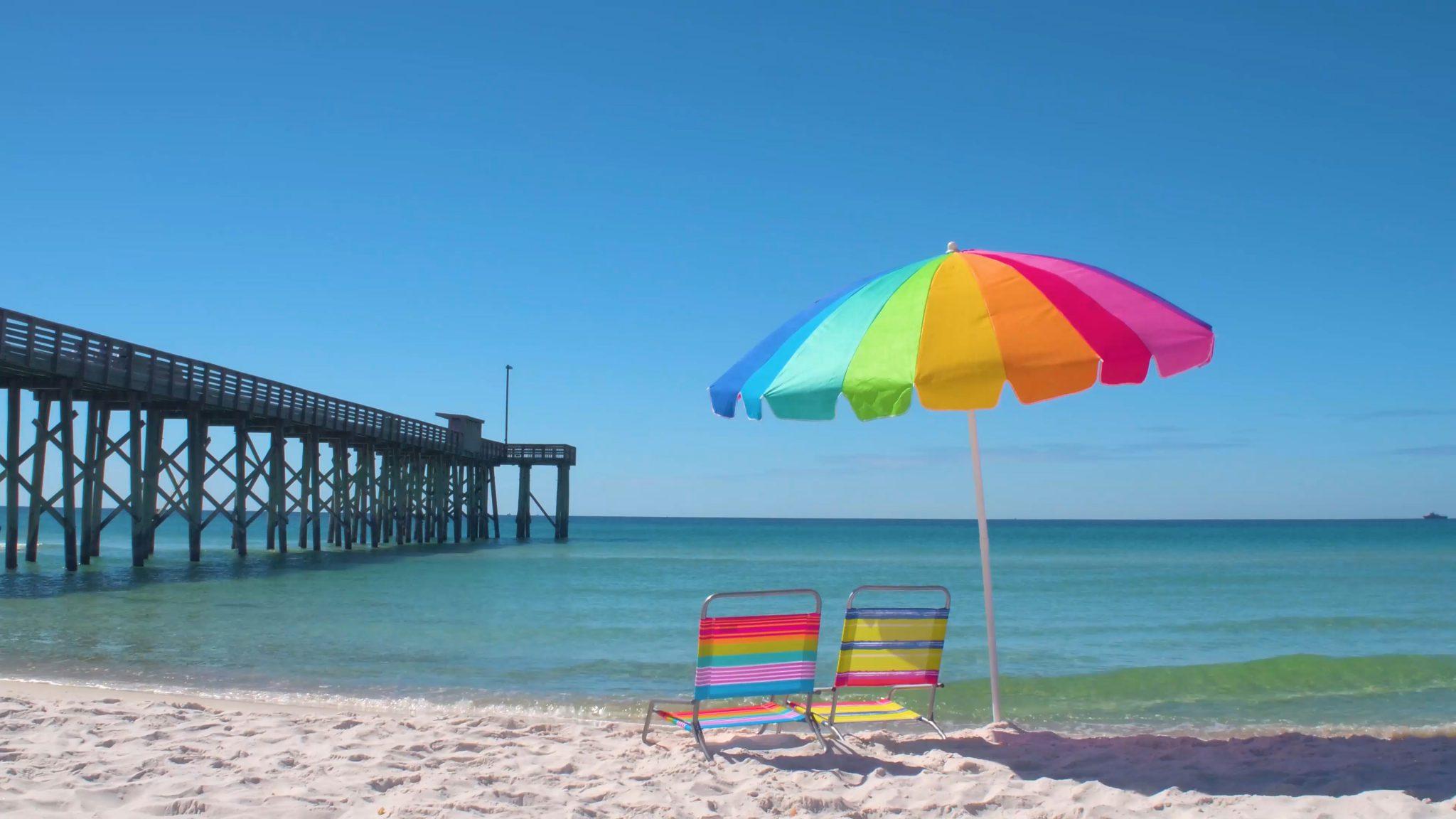 rainbow umbrella beach chairs